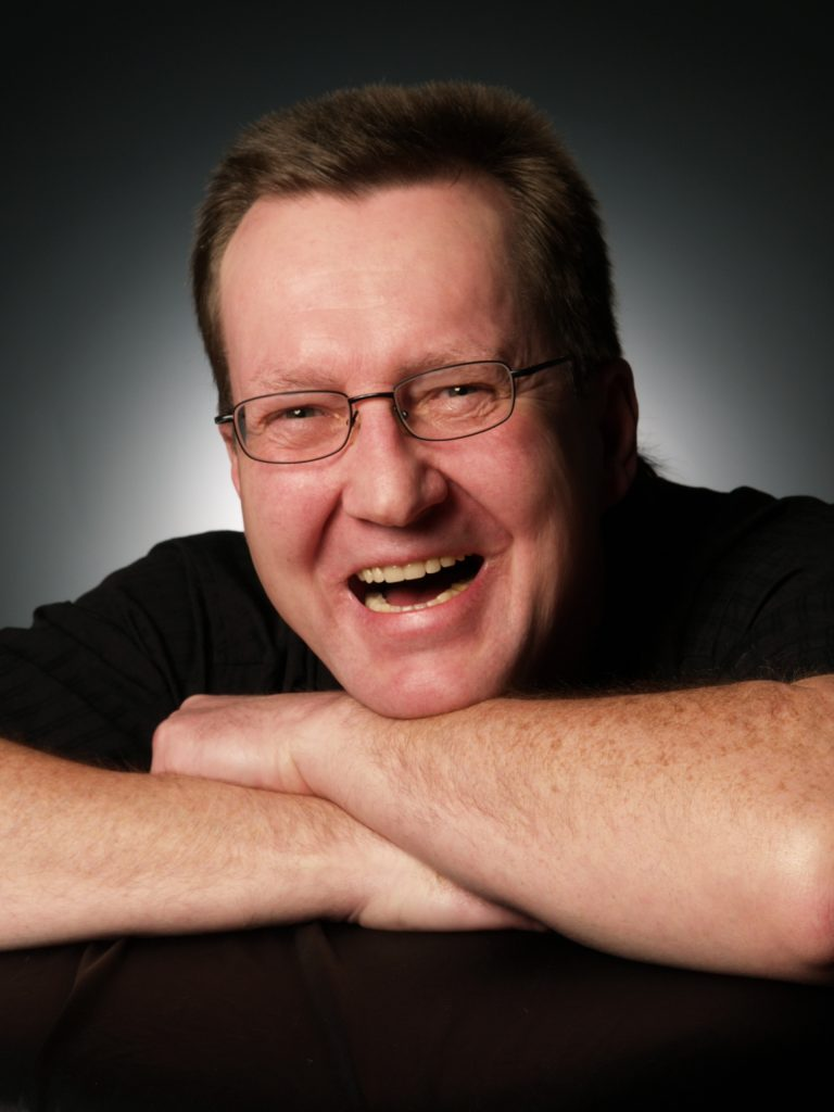 man with a smile and straight teeth from Invisalign